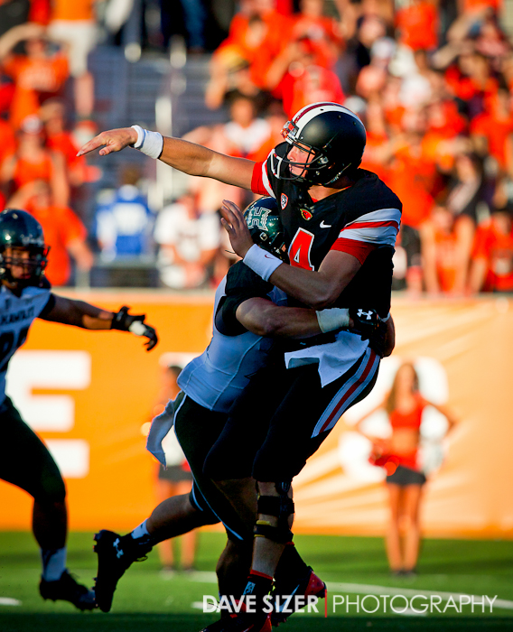 Sean Mannion gets hit right as he unloads a pass.