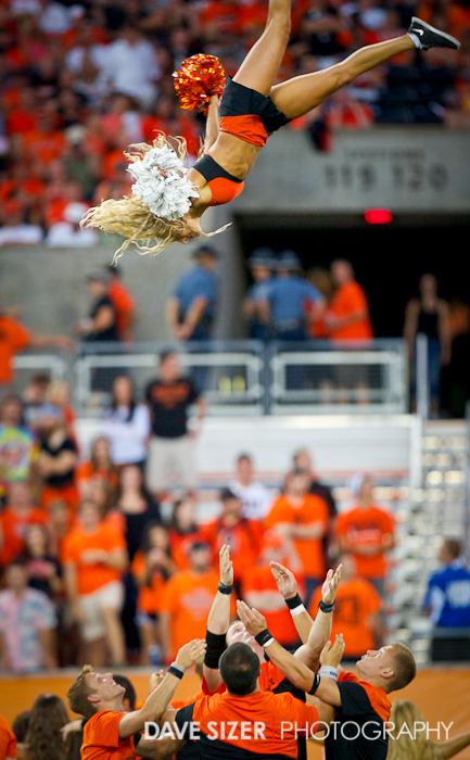 An Oregon State cheerleader gets some major air during a break in the game.