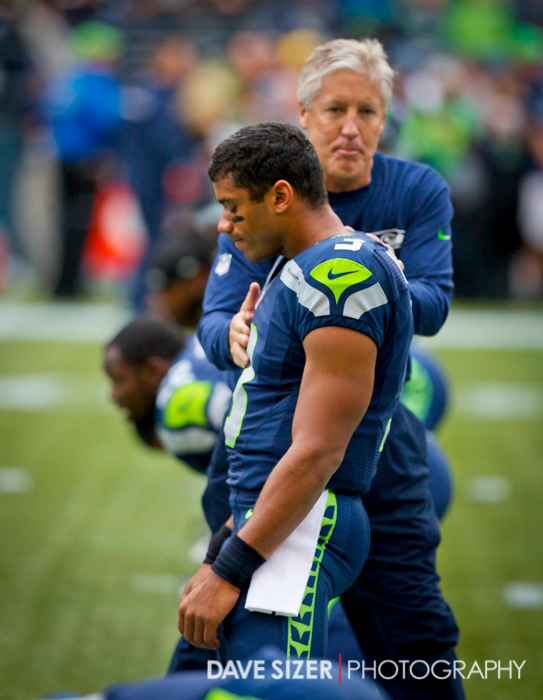 Coach Carroll chats with Russell Wilson during pre game stretching.