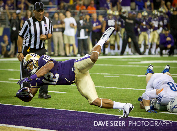 Dwayne Washington leaps into the endzone near the end of the game to seal the victory.