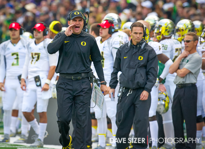 First year Head Coach Mark Helfrich calls in to one of his players.
