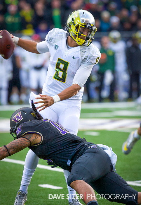Marcus Mariota pushes past John Timu.