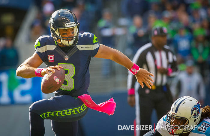 Russell Wilson's speed gets him away from this Titans defender.