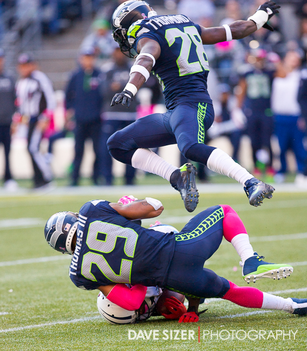Earl Thomas and Walter Thurmond converge on the Tennessee receiver.