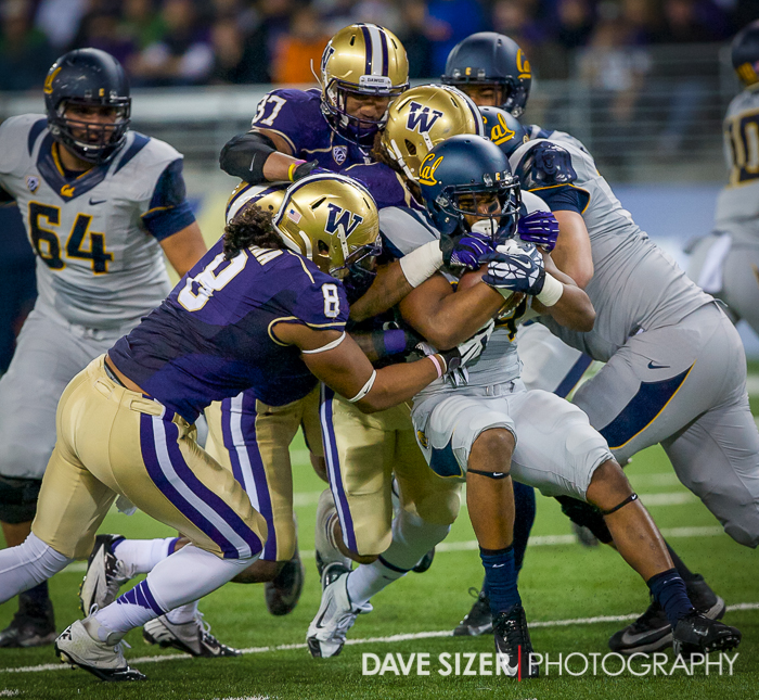 The Husky Defense swarms on RB Darren Ervin.