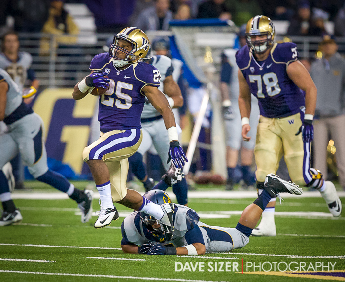 Husky RB Bishop Sankey slips the last Cal Defender...