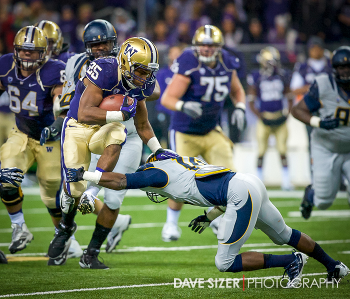 Bishop Sankey hurdles a Cal Defender.