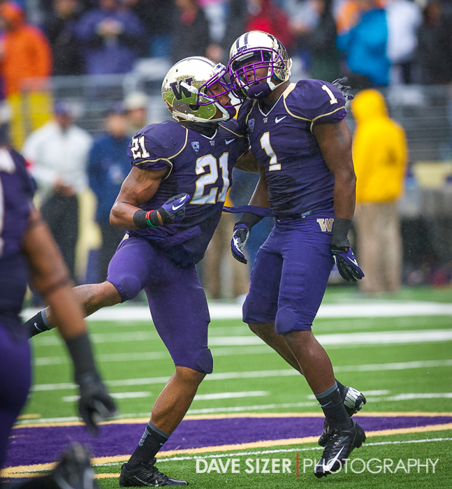 Marcus Peters and Sean Parker celebrate after Parker's INT.