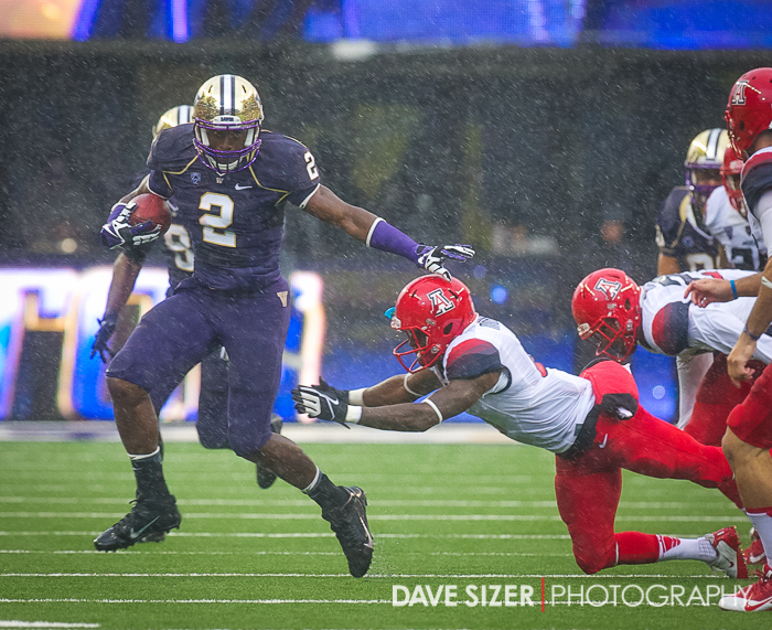 Kasen Williams with a long punt return in the driving rain.