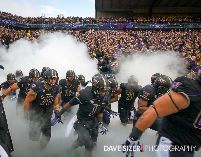 The blacked-out Huskies emerge from the tunnel.