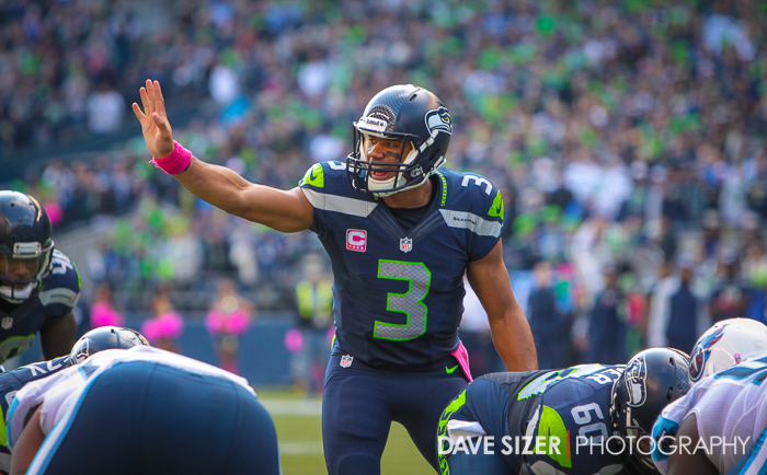 Russell Wilson directs his team at the line.
