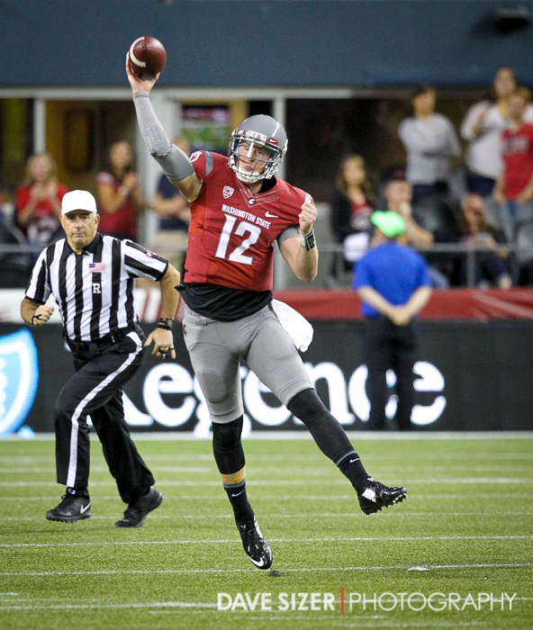 Connor Halliday throws on the run.