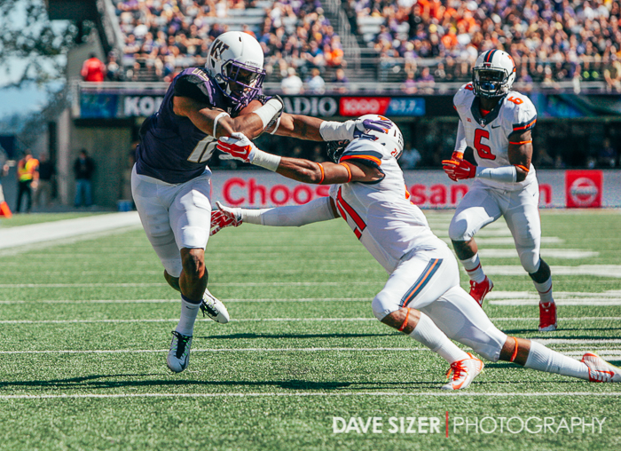 Dwayne Washington stiff arms an Illini defender.