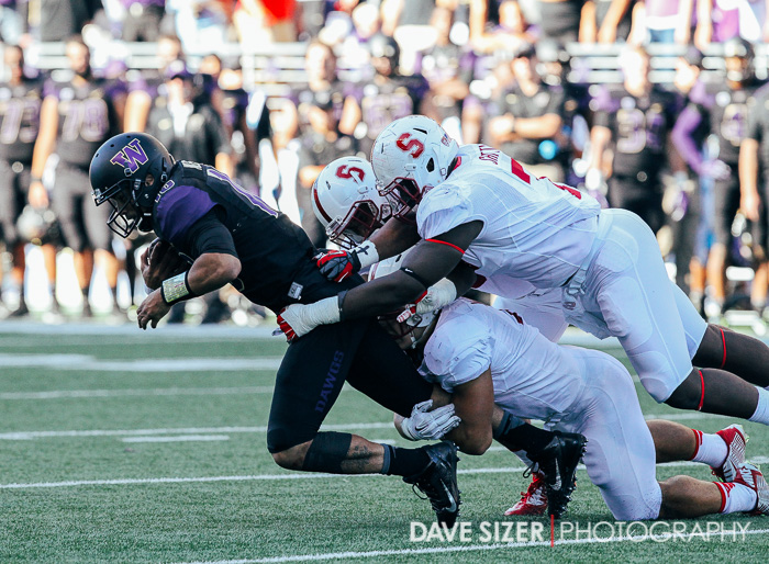 Several Cardinal defenders bring down Cyler Miles.