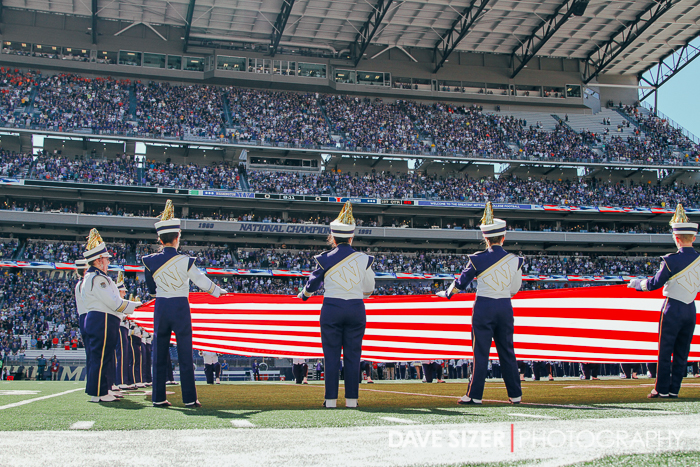 The band displays the flag during the National Anthem.