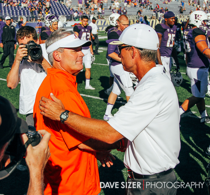 Head coaches Chris Peterson and Tim Beckman shake hands after the game.