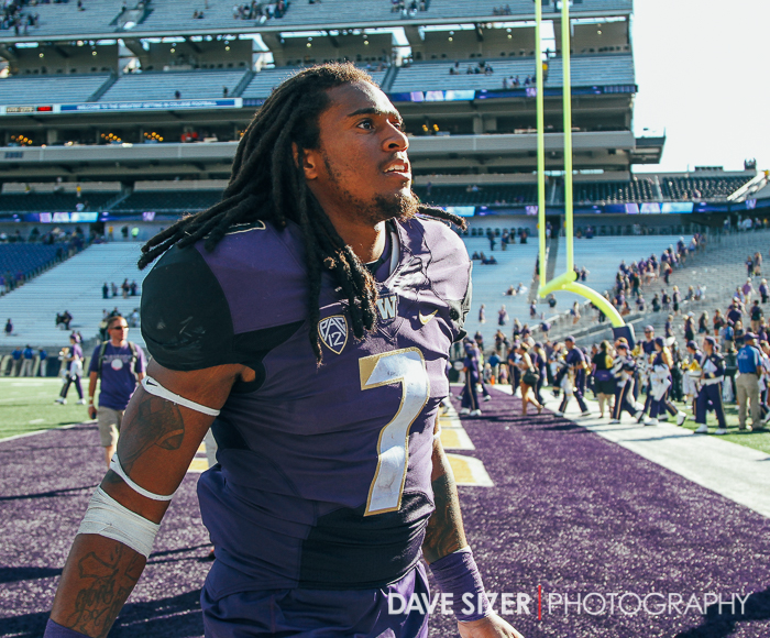 The game's star Shaq Thompson leaves the field to a loud ovation.