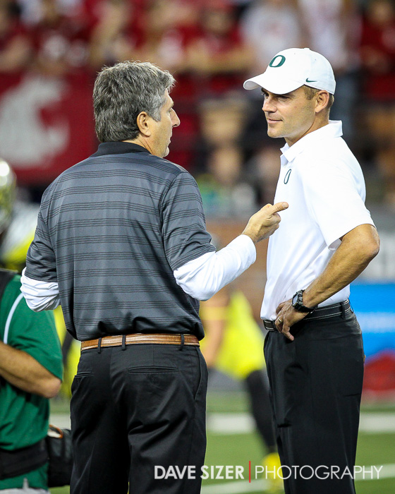 Head Coaches Mike Leach and Mark Helfrich chat before the game.