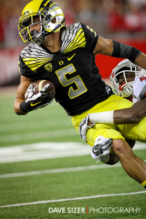 Devon Allen tries to spin out of this tackle.
