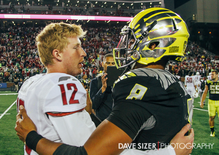The two QBs that combined for 765 yards congratulate each other at mid-field after the game.