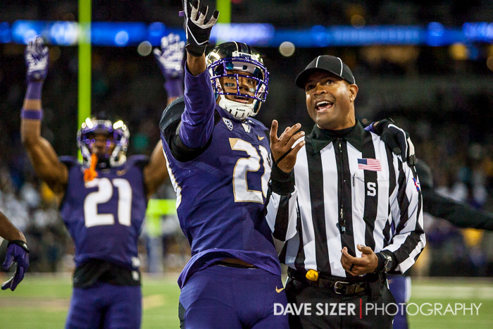 Kevin King pleads with the referee as they watch the replay on the screen.  The call was reversed in the Huskies favor.