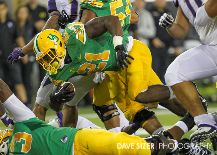Royce Freeman dives over the pile.
