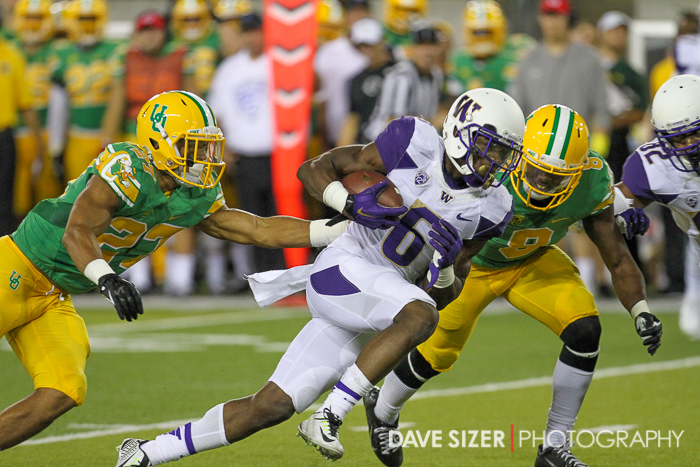 Deontae Cooper drives ahead for more yardage.