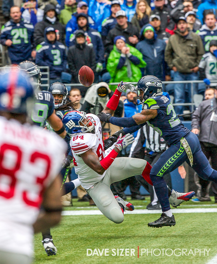 The Seahawks defense breaks up this pass in the end zone intended for Larry Donnell