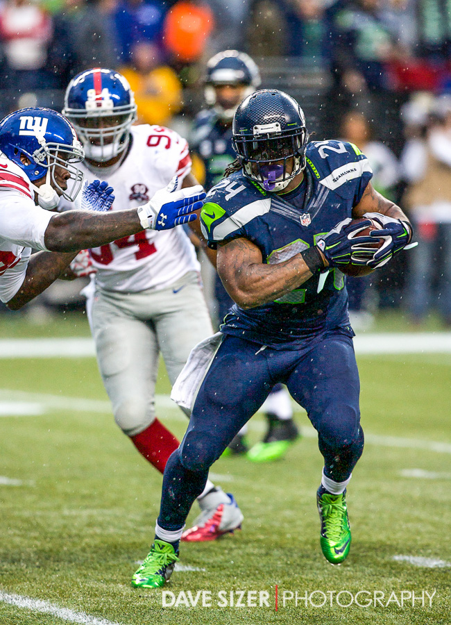 Marshawn Lynch breaking tackles.