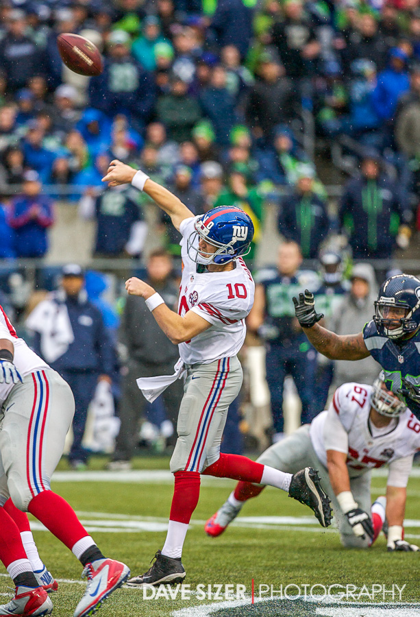 Eli Manning fires a bomb from mid-field into the end zone...