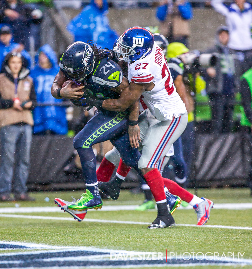 Lynch carries a couple of Giants into the end zone with him on this score.