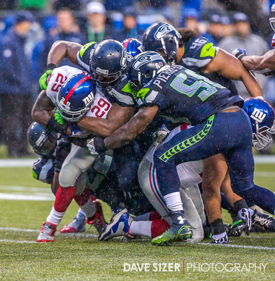 The Seahawks swarm to bring down Michael Cox.