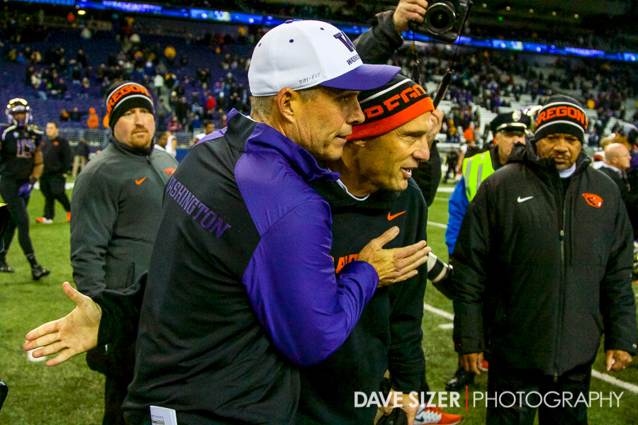 Coaches Mike Riley and Chris Petersen shake hands after the game.