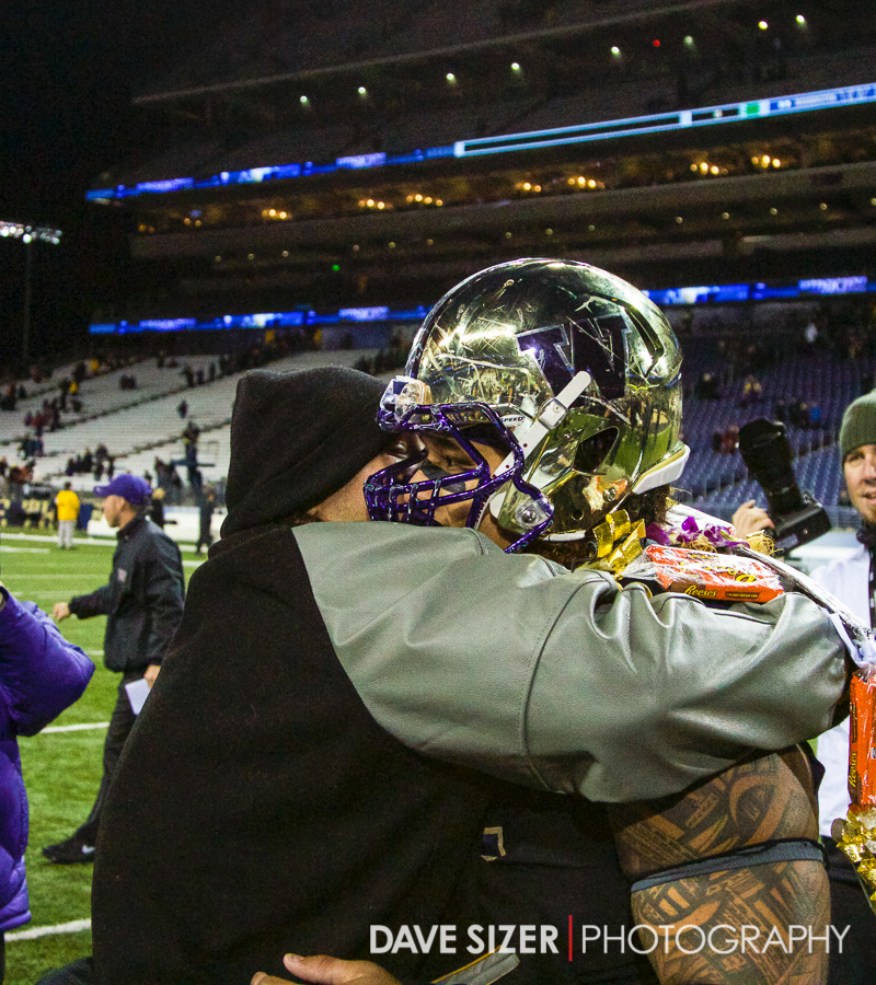 Danny Shelton gets a hug from a family member after the game.