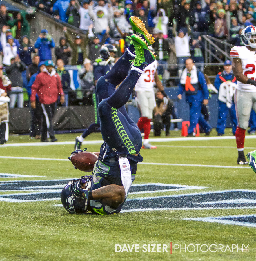 Lynch adds his flair with a head-stand.