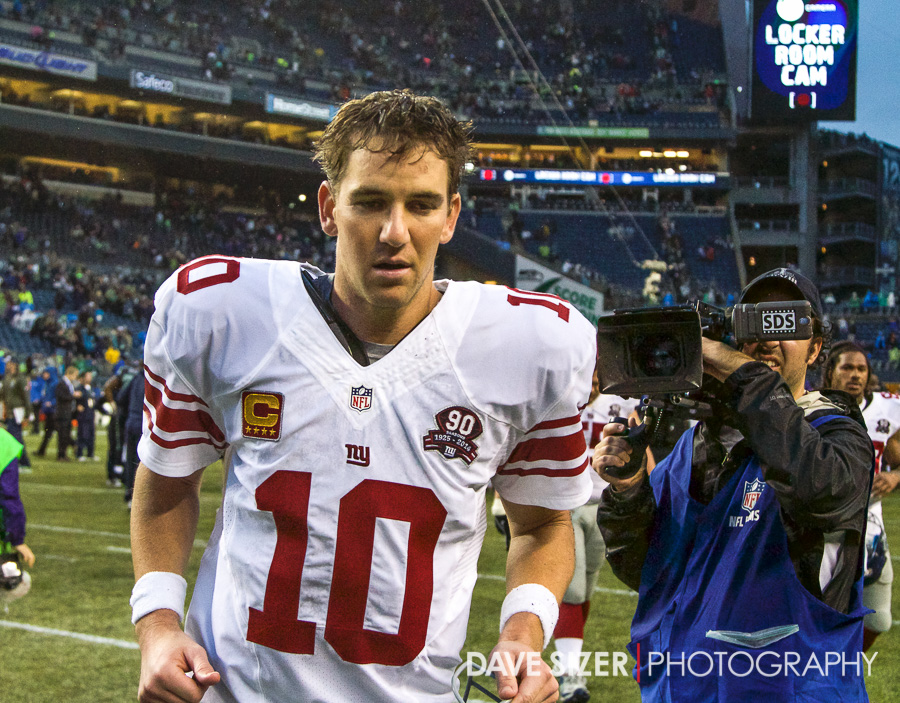 Eli Manning trots off the field after the game. Eli Manning trots off the field after the game.