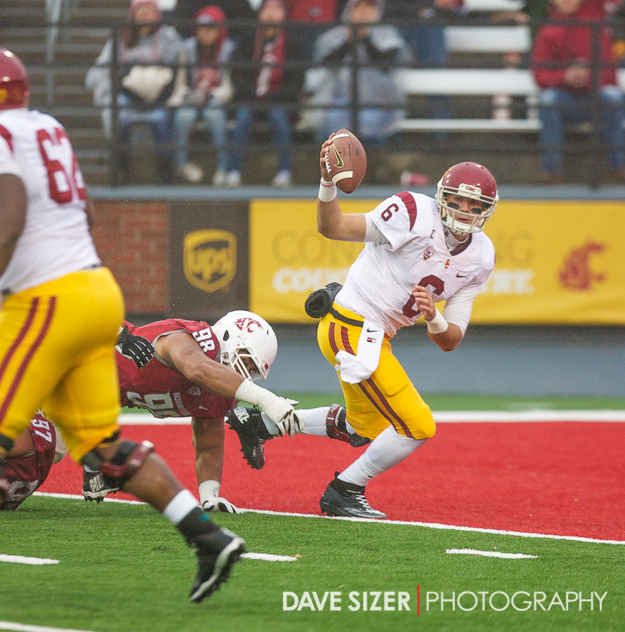 USC Quarterback Cody Kessler scrambles away under heavy pressure.