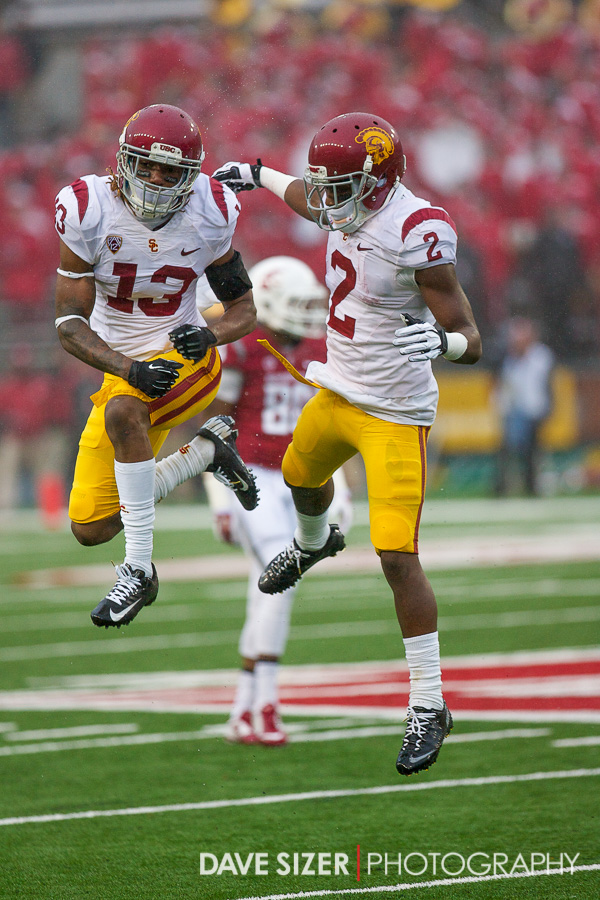 Kevin Seymour and Adoree' Jackson sky high in celebration after a stop.