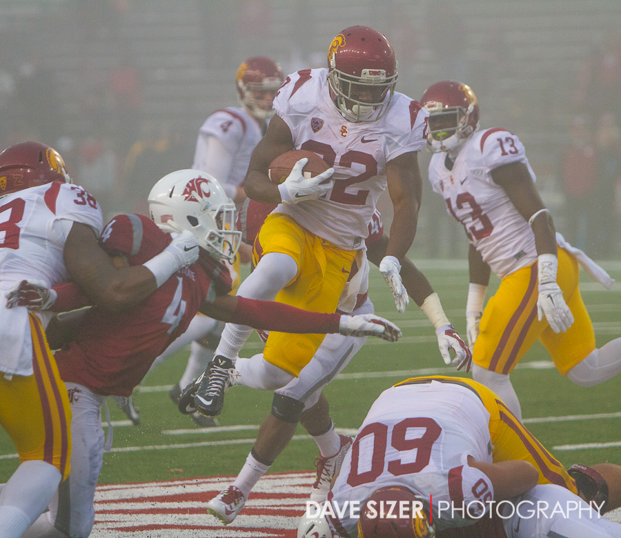 Justin Davis jumps through the defense as the fog gets thick near the end of the game.
