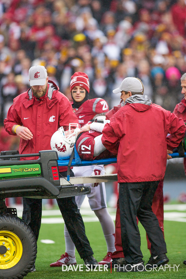 Connor Halliday gets loaded onto the cart and taken off the field.
