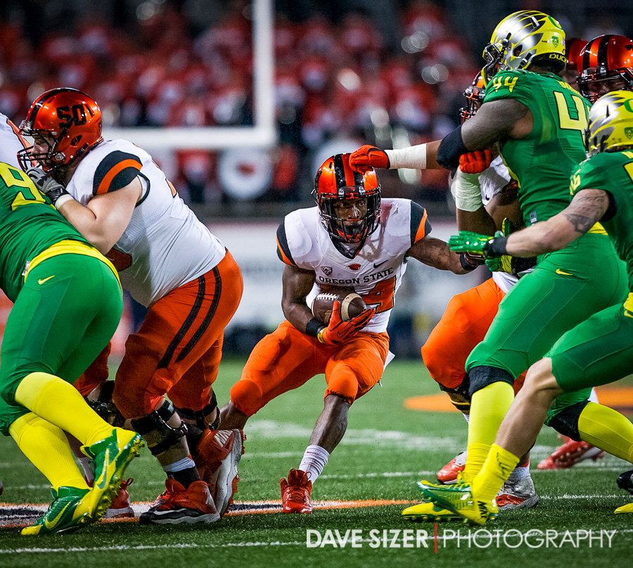 Storm Woods (best name in college football) carves through a flock of ducks for yardage.