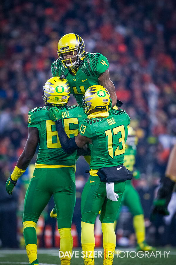 The Ducks D celebrate after a stop.