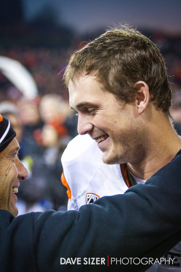 Head Coach Mike Riley shares a laugh with Senior QB Sean Mannion during introductions of the Seniors.