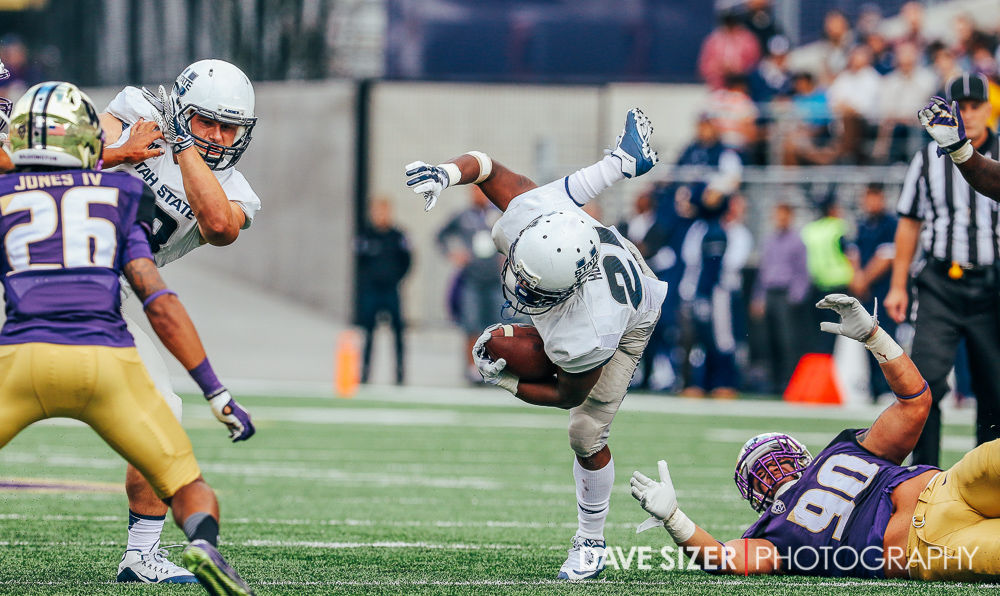 USU RB LaJuan Hunt tries to keep his balance on this run.
