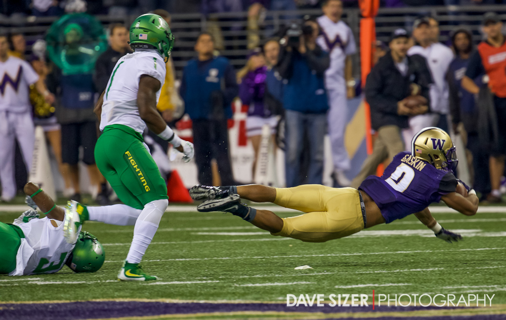 Myles Gaskin gets tripped up.
