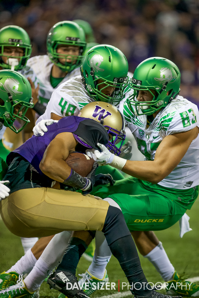 Myles Gaskin gets swarmed by the Ducks Defense.