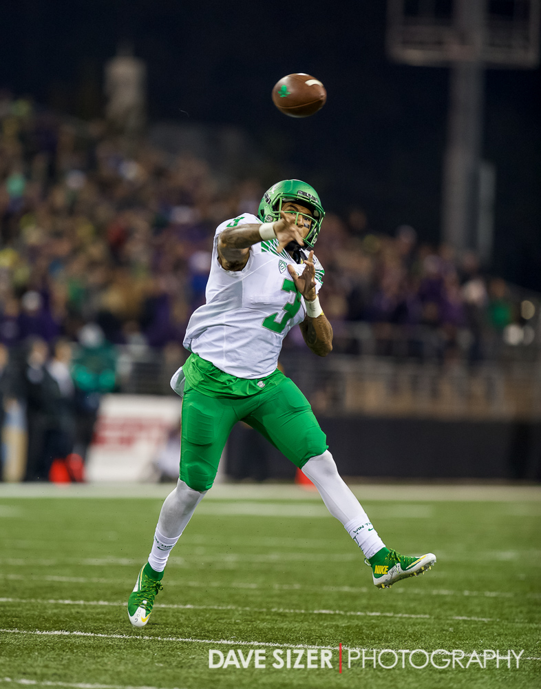 Vernon Adams throws on the run.