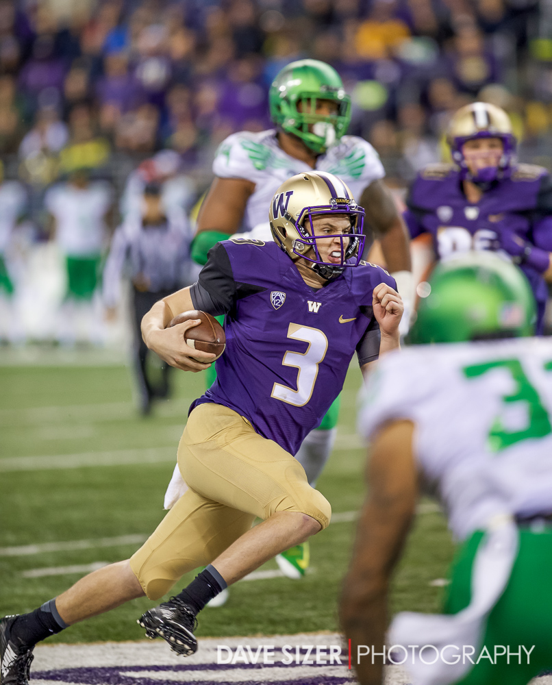 Jake Browning scrambles for yards.