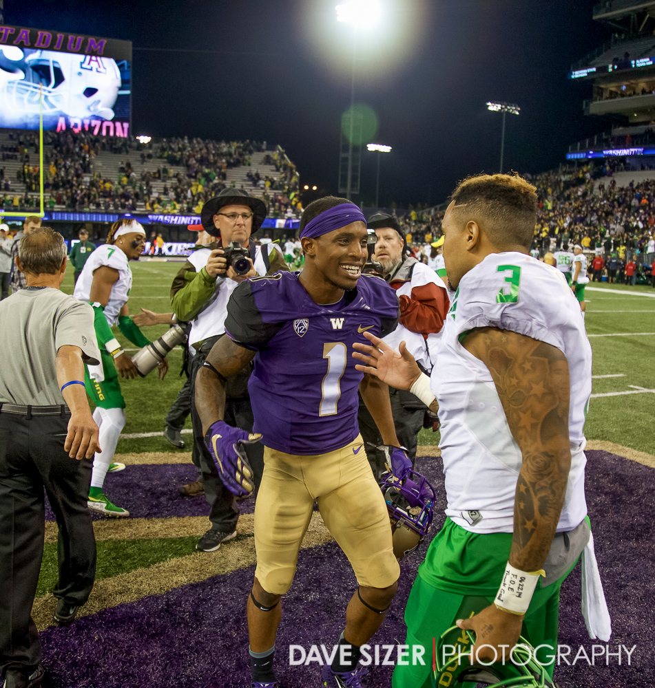 Jaydon Mickens and Vernon Adams congratulate each other after the game.