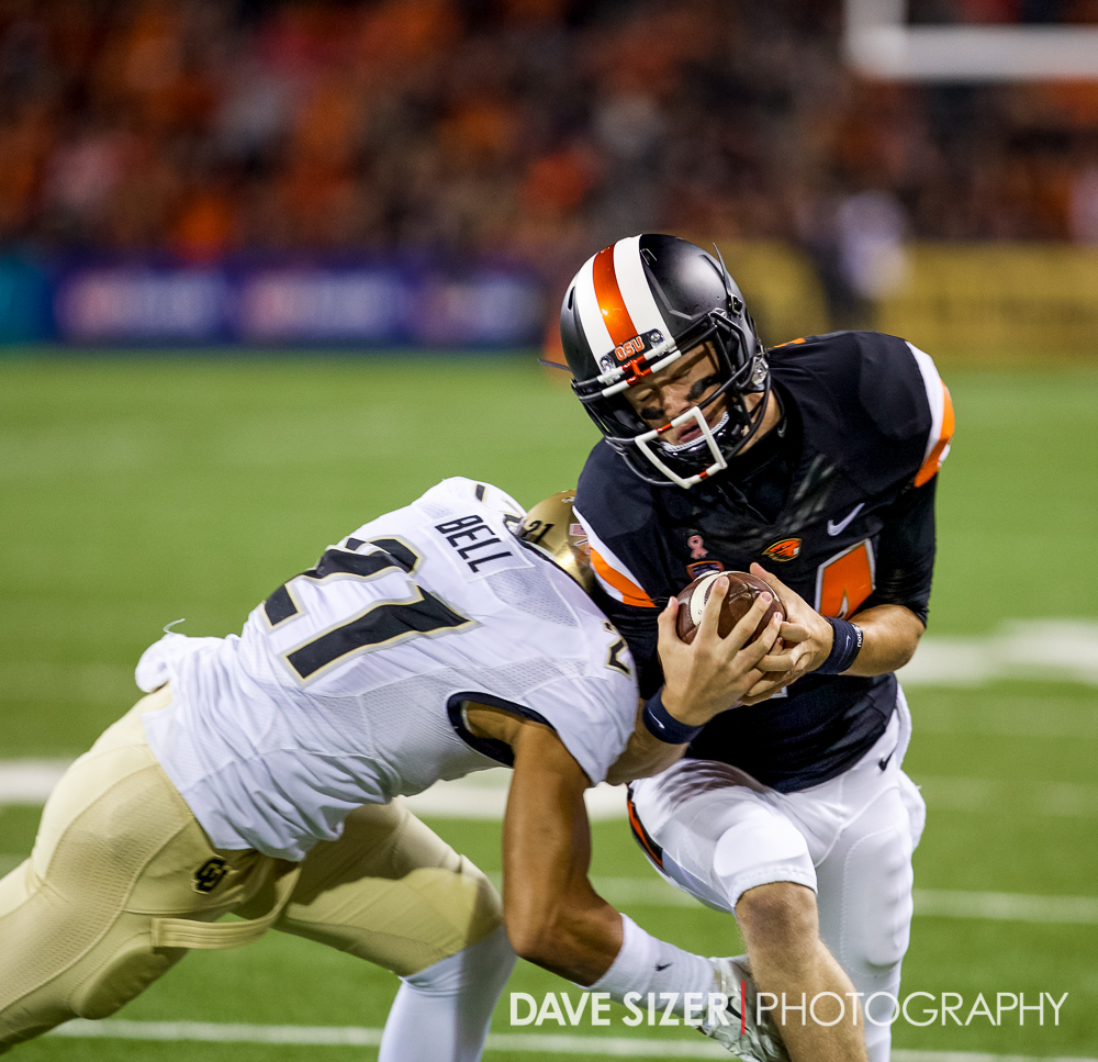 Oregon State's other QB Nick Mitchell takes a hard hit.